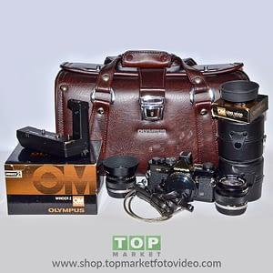 Olympus OM N2 bundle fotocamera analogica + 28 mm + 50mm + Borsa + Libro + Cavetto Autoscatto + Winder